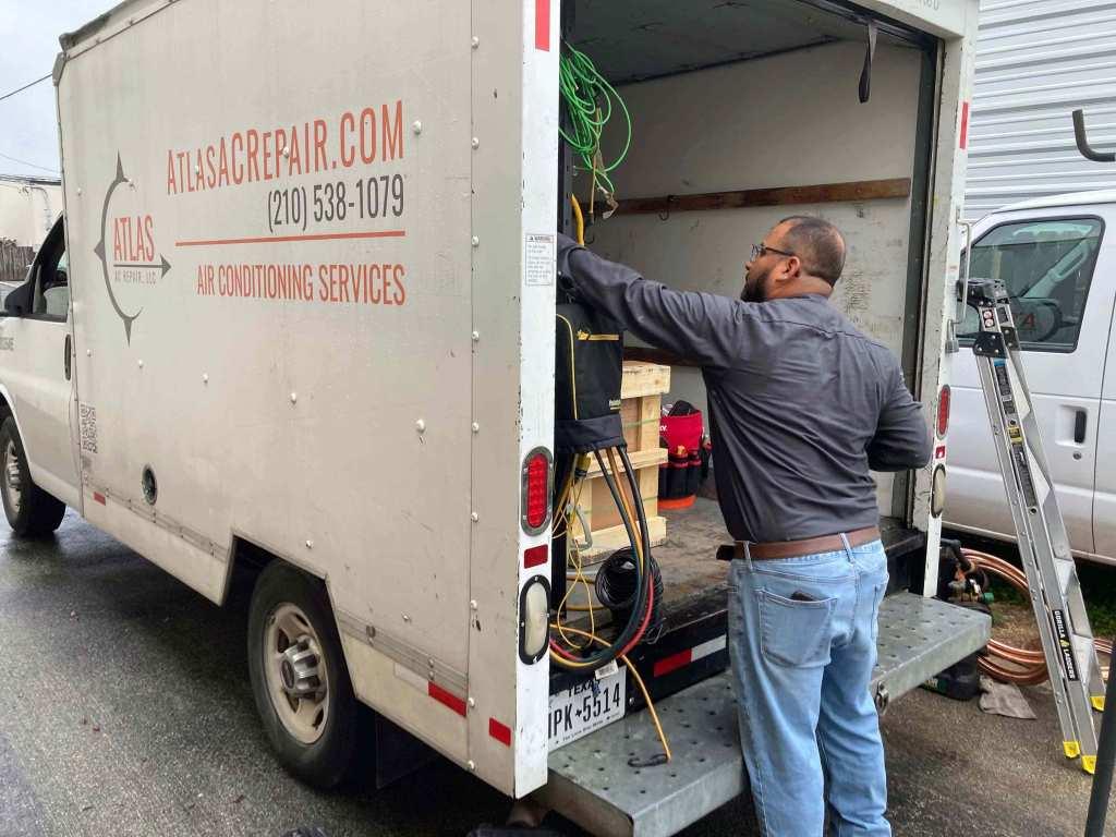 HVAC tech loading company van