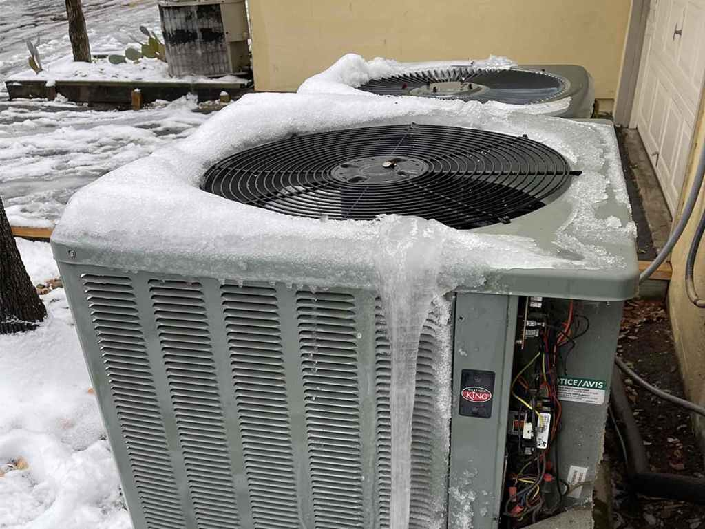 Ice covered AC condenser